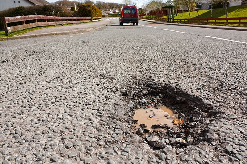 safely deal with potholes