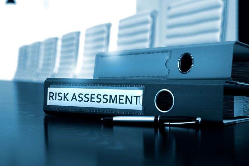 "binder labeled ""risk assessment,""common business insurance claims"