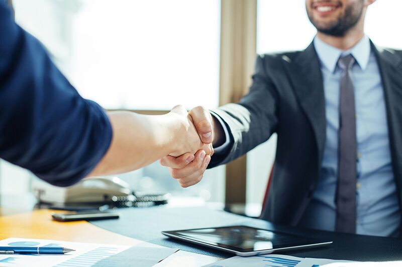 businessmen shaking hands, what additional insured status means for your coverage