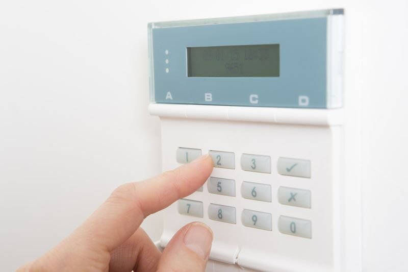 close up of security panel, why you should get a home security system