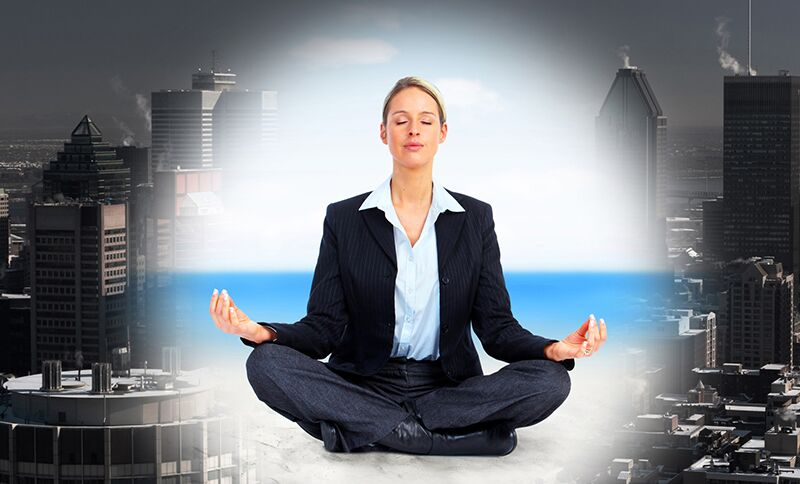 woman in business clothes meditating, National Mental Health Awareness Month