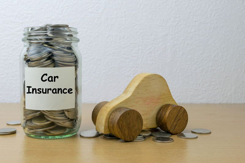 toy car next to jar of coins, auto insurance points