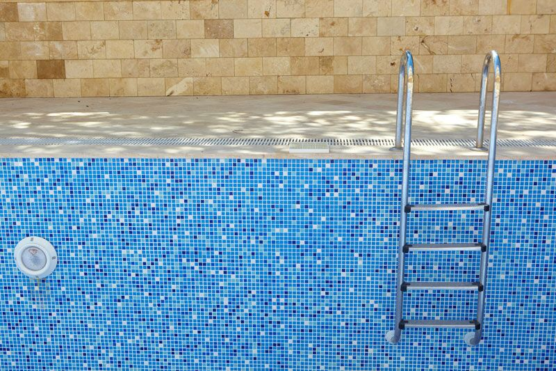 pool with ladder, consider these factors before building an inground pool on your property