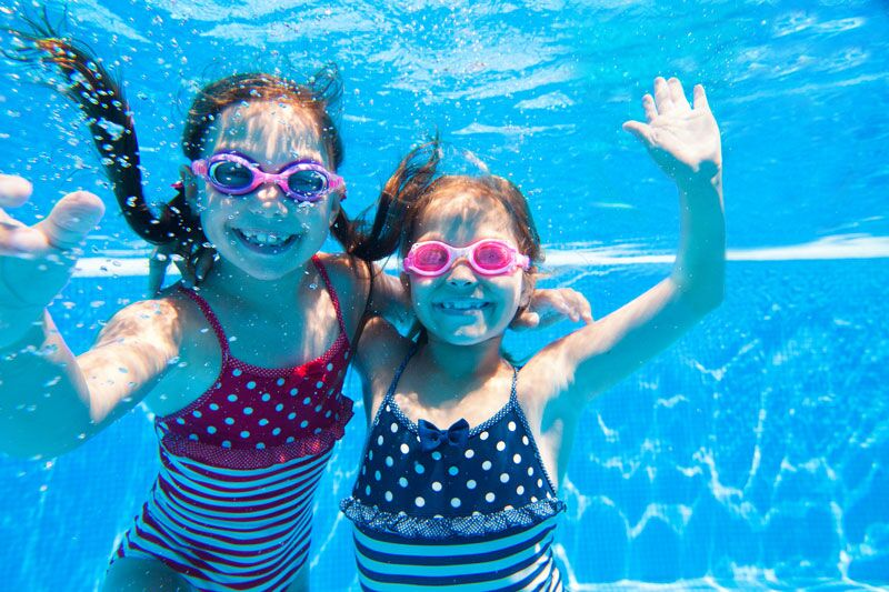 two kids swimming, keep your kids safe in the pool this summer