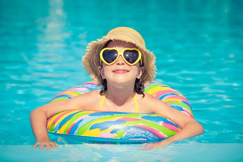 staying cool in the pool, protect yourself from the heat this summer
