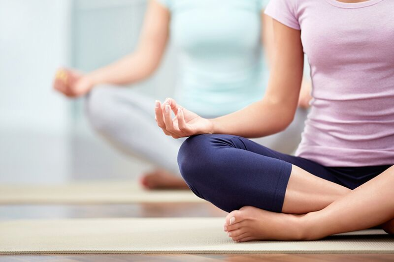 women in yoga class, top health benefits of yoga