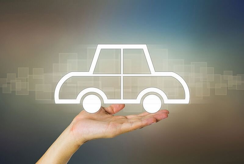 hand holding up picture of a car, how to choose the right auto insurance