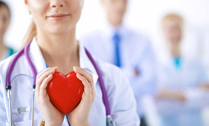 doctor holding a red toy heart, truth about heart disease and cardiovascular health
