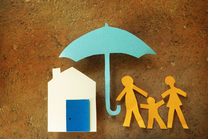paper cut-outs of an umbrella shielding a home and family, surprising homeowners insurance coverages