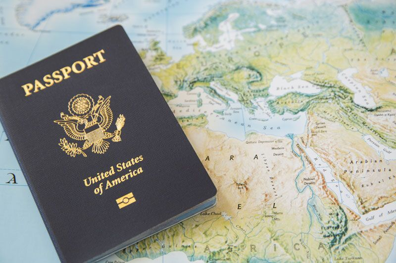 passport on world map, travel insurance